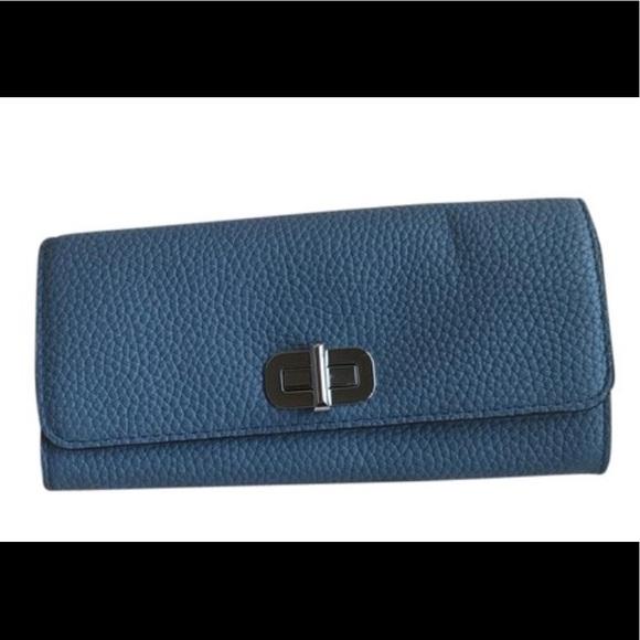 a283a94ce3c0 Michael Kors Bags | Blue Sullivan Large Carryall Wallet | Poshmark